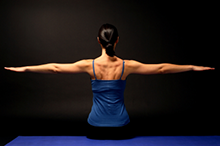 woman stretching out arms: pilates instructor harpenden