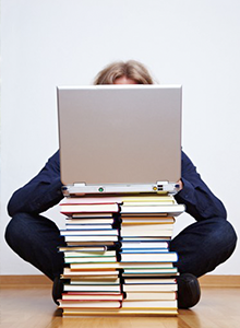 books and laptop: ergonomic workstation assessment hertfordshire