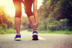 Runner with injured lower leg knee physiotherapy harpenden