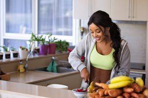 Women cutting up fruit