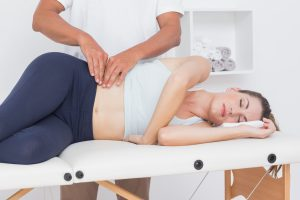 woman recieving hips pelvis physiotherapy: women's health physiotherapy hertfordshire