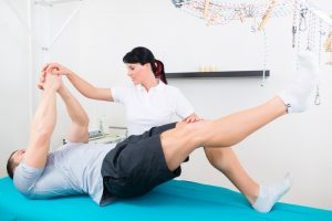 Physiotherapy Services Hertfordshire team member helping a patient: musculoskeletal physio