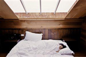 Sleeping woman underneath skylight